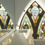 Master bathroom with stained glass window in a converted church condo building Chicago | Solstice Stained Glass